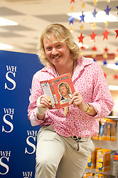 "Leigh Francis in character as TV JUICE host Keith Lemon poses for for the press at WHSmith Meadowhall shopping centre in Sheffield. during his book tour for 'Keith Lemon: The Rules""  The event scheduled for 5:00 - 5:30 was so popular that Keith started signing early and didn't finish until 7:05pm as well as sales of the book being restricted.  .1st November 2011. Image © Paul David Drabble"
