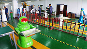 """HARBIN, CHINA - JUNE 07: (CHINA OUT) <br /> <br />  A robot tries delivering meals on June 7, 2015 in Harbin, Heilongjiang province of China. A Haiying robot manufacturer in north China\'s Harbin Harbin Economic and Technological Development Zone has developed into a comprehensive company where multifunctional robots could be made out to work on the land, in water and air. Liu Hasheng, chief manager and founder of the robot manufacturer, opened the first conprehensive robots restaurant in China with \""""waiters\"""" produced by his own company. According to Liu Hasheng, those robot waiters have been sold out throught out country and his orders has also a great business opportunity in the future.<br /> ©Exclusivepix Media"""