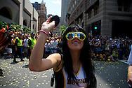 June 18, 2011, Boston, MA - A Bruins dancer throws a souvenir puck to a fan. Photo by Lathan Goumas