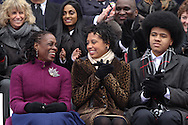 Chirlane McCray, reacts to husband  Bill de Blasio's speech with their daughter Chiara, and son Dante, during his inaugural ceremony at City Hall.