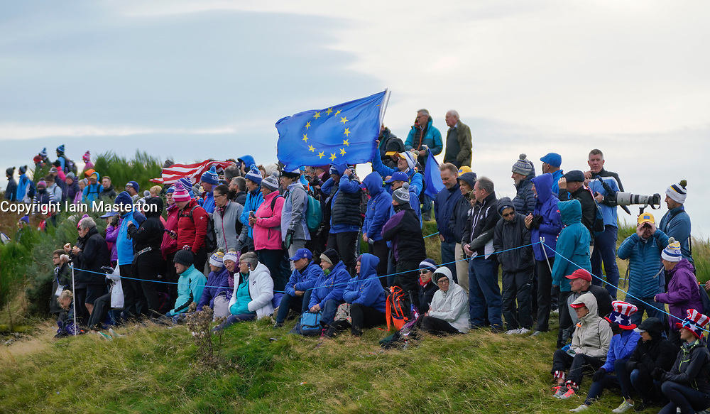 Auchterarder, Scotland, UK. 14 September 2019. Saturday morning Foresomes matches  at 2019 Solheim Cup on Centenary Course at Gleneagles. Pictured; Team Europe spectators in warm weather clothes watch beside the 7th green. Iain Masterton/Alamy Live News