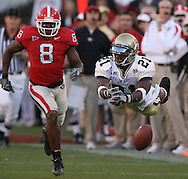 ATHENS, GA: Georgia Tech's Calvin Johnson(21) dives for ball  against UGA's Paul Oliver  in the  second  quarter at Samford Stadium on Saturday,11/25/06.  ©2006 Johnny Crawford