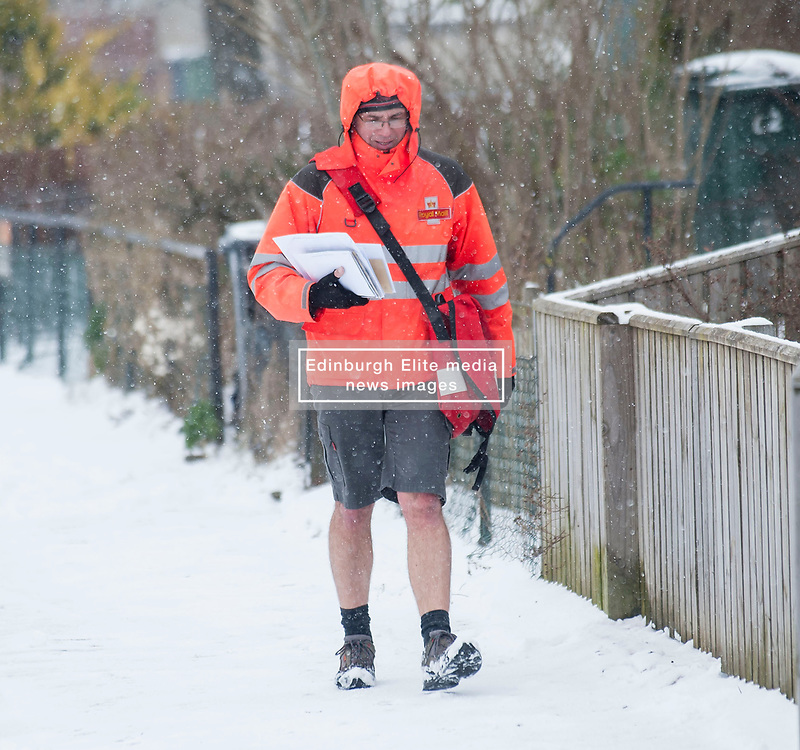 The severe winter weather gripping Scotland had bypassed this postman, spotted on his rounds in Ratho Station just outside Edinburgh, dressed in shorts.<br /> <br /> © Dave Johnston / EEm