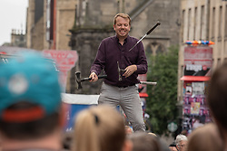 A juggler entertains the crowds on Edinburgh's Royal Mile.<br /> <br /> <br /> © Jon Davey/ EEm