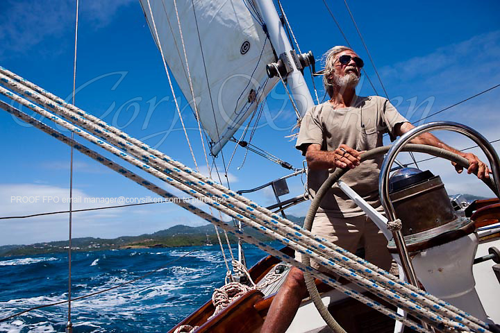 Fred Thomas at the helm, onboard Apollonia during the Grenada Classic Yacht Regatta.
