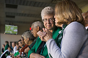 Ruthie Nellies talks to guests while watching the football game against the Hampton Pirates on Sept. 2, 2017 in the Presidents box at Peden Stadium