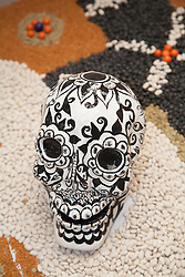 North America, Mexico, Guanajuato State, Guanajuato,  painted skull and design made of beans for Day of the Dead.  Guanajuato is a UNESCO World Heritage Site.