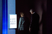 Hillary Rodham Clinton and her husband, former President Bill Clinton exits the stage after opening the 2013 Clinton Global Initiative meeting in New York.