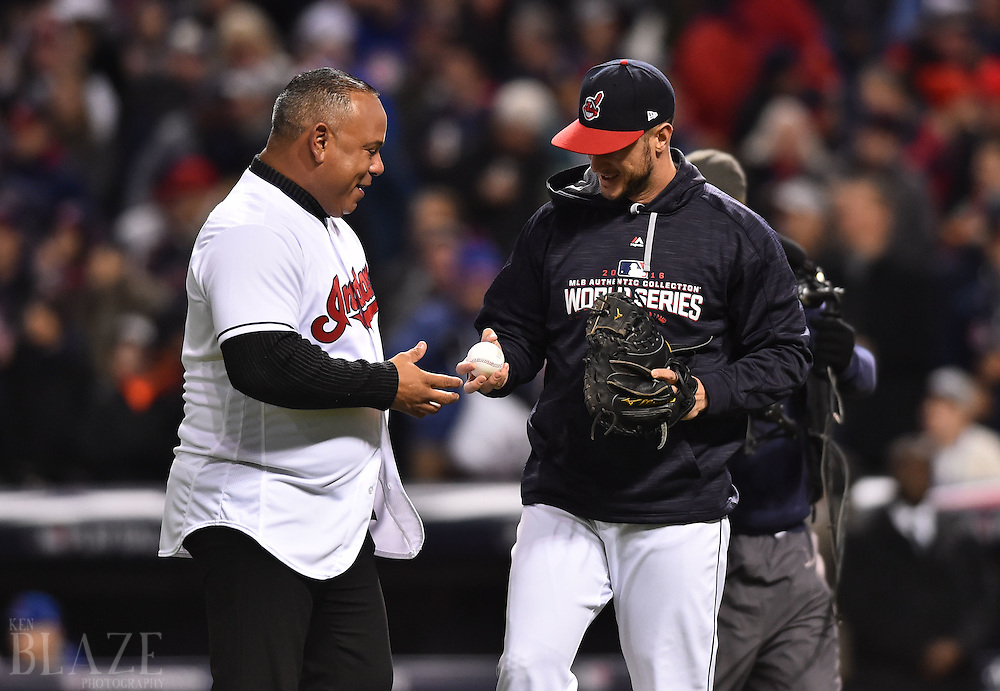 Oct 26, 2016; Cleveland, OH, USA; Cleveland Indians former player Carlos Baerga (left) greets catcher Yan Gomes (right) after throwing out the ceremonial first pitch before game two of the 2016 World Series against the Chicago Cubs at Progressive Field. Mandatory Credit: Ken Blaze-USA TODAY Sports