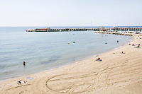 ACCIAROLI, ITALY - 14 SEPTEMBER 2018: A view of the beach in Acciaroli, a small fishing village in the municipality of Pollica, Italy, on September 14th 2018.<br /> <br /> To understand how people can live longer throughout the world, researchers at University of California, San Diego School of Medicine have teamed up with colleagues at University of Rome La Sapienza to study a group of 300 citizens, all over 100 years old, living in Acciaroli (Pollica), a remote Italian village nestled between the ocean and mountains in Cilento, southern Italy.<br /> <br /> About 1-in-60 of the area's inhabitants are older than 90, according to the researchers. Such a concentration rivals that of other so-called blue zones, like Sardinia and Okinawa, which have unusually large percentages of very old people. In the 2010 census, about 1-in-163 Americans were 90 or older.