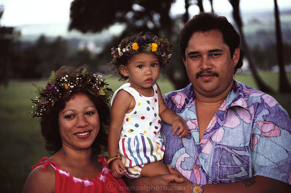 Hilo Hawaii. Husband and wife with young daughter at the Hula festival.