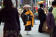A holy man collecting alms in Tokyo, Japan
