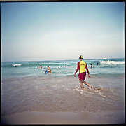Surf rescue lifeguard on Manly Beach. Picture taken with a Holga. Surf rescue on the beach