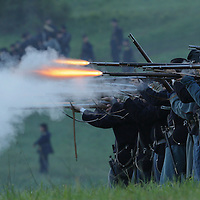 Union soldiers advance and fire on the Confederates during a sunrise reenactment of Donelson's Attack, part of a weekend of events commemorating the 150th anniversary of the Battle of Perryville in Perryville, Ky. Saturday October 6, 2012.  Photo by David Stephenson