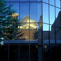 The 6th & I Synagogue in Washington, DC is reflected in the windows of the old DC Convention Center.