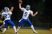 JEROME A. POLLOS/Press..Coeur d'Alene High quarterback Ryan Dunton leaps to clear the defense while making a throw.