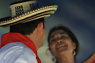 Carmen Dence performs a traditional slow Colombian cumbia dance with a male partner at the Festival of Nations celebration in Tower Grove Park; St. Louis, Missouri.