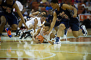 George King (24) of San Antonio Northside Brennan dives for a loose ball during the UIL Conference 4A semifinals against Dallas Kimball at the Frank Erwin Center in Austin on Thursday, March 7, 2013. (Cooper Neill/The Dallas Morning News)