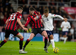 BOURNEMOUTH, ENGLAND - Saturday, December 7, 2019: Liverpool's Roberto Firmino (R) and AFC Bournemouth's Jack Simpson during the FA Premier League match between AFC Bournemouth and Liverpool FC at the Vitality Stadium. (Pic by David Rawcliffe/Propaganda)
