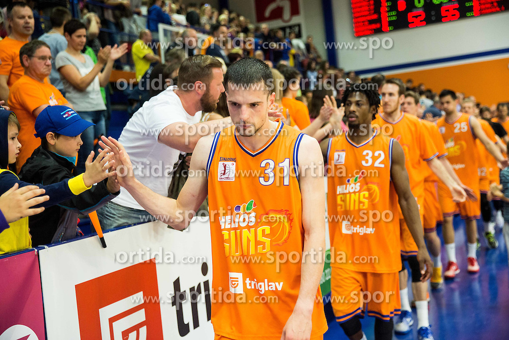 Djordje Lelic of KK Helios Suns looks dejected after the 2nd Leg basketball match between KK Helios Suns and KK Zlatorog Lasko in Final of Nova KBM Champions League  2015/16, on May 31, 2016 in Hala Komunalnega centra, Domzale, Slovenia Photo by Vid Ponikvar / Sportida