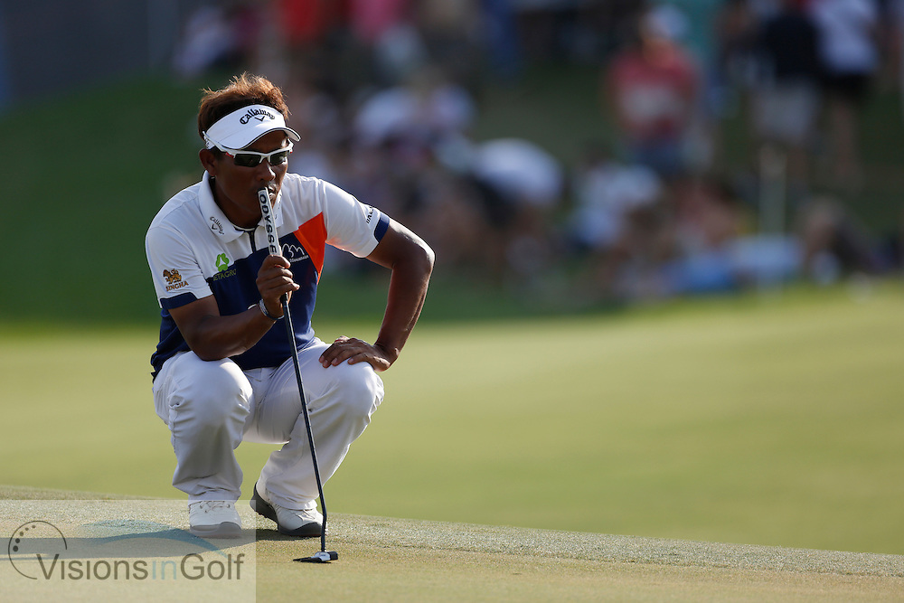 Thongchai Jaidee<br /> during the third round of the Race To Dubai DP World Tour Golf Championship, Dubai, UAE November  2013<br /> Picture Credit:  Mark Newcombe / www.visionsingolf.com