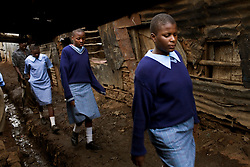 Children walk home from school in Mathare, one of the poorest slums in Nairobi.  Running water and electricity are scarce and trash and human waste fills the streets.  Many people have no jobs and those who do work can earn less than one dollar a day.