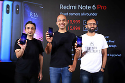November 22, 2018 - New Delhi, India - From left to right: Anuj Sharma, Head of Marketing, Xiaomi India;.Manu Jain, Global Vice President, Xiaomi & Managing Director, Xiaomi.India ; Raghu Reddy, Head of Online Sales, India, Xiaomi.Technology.during the launch of Xiaomi Redmi Note 6 Pro (Credit Image: © Jyoti Kapoor/Pacific Press via ZUMA Wire)
