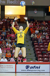 23 October 2010: Mary Elizabeth Hooper floats in the air while setting the ball during an NCAA, Missouri Valley Conference volleyball match between the Wichita State Shockers and the Illinois State Redbirds at Redbird Arena in Normal Illinois.