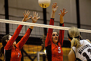 1 Nov. 2011 -- EDWARDSVILLE, Ill. -- Edwardsville High School girls' volleyball players Tori Guswelle (7) and Sarah Parker (5) leap to block a spike attempt by Belleville West High School's Taylor Puuri (11) during the IHSA Class 4A girls volleyball sectional semifinal at Edwardsville High School in Edwardsville, Ill. Tuesday, Nov. 1, 2011. Edwardsville won, 2-1. Photo © copyright 2011 Sid Hastings.