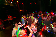 Students dance during a silent disco in the Fredric March Play Circle at Sunburst Festival in Memorial Union in 2014.