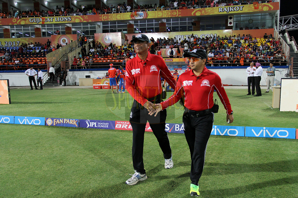 Umpires Sundaram Ravi and Virender Sharma arrive for the start of the 2nd inning of the match 20 of the Vivo 2017 Indian Premier League between the Gujarat Lions and the Royal Challengers Bangalore  held at the Saurashtra Cricket Association Stadium in Rajkot, India on the 18th April 2017<br /> <br /> Photo by Vipin Pawar - Sportzpics - IPL