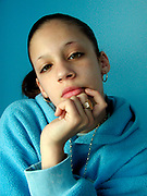 Girl with a nose stud wearing a blue hoodie and sovereign ring