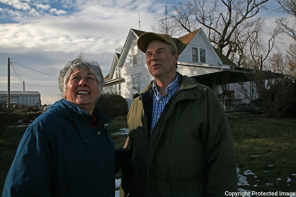 "On a seasonably warm day in January, Karen and Bill Johnson enjoy the sunshine and beautiful sky on their family farm in Shelby County, Iowa.  The Johnson's have been farming together since their marriage in 1968.  <br /> <br /> ""We lived through the 80's by the skin of our teeth,"" says Karen, referring to the lean economic years of the farm crisis.  <br /> <br /> The Johnson's, who plant 1330 acres of corn, soybeans and alfalfa, along with tending to a small herd of cattle, don't plan to retire anytime soon.  <br /> <br /> ""Neither of us has a notion of moving into town and having neighbors 5 feet from our front door,"" says Karen.  .  Photo by David Peterson"