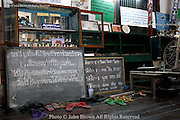 Signs written in Thai greet visitors at the entrance of the Wat Gate Khar Rnam Museum, located in the old district of Chiang Mai, Thailand. This area was first settled by Chinese immigrants and the museum contains many antiques and artifacts, as well as an historic collection of old photographs.