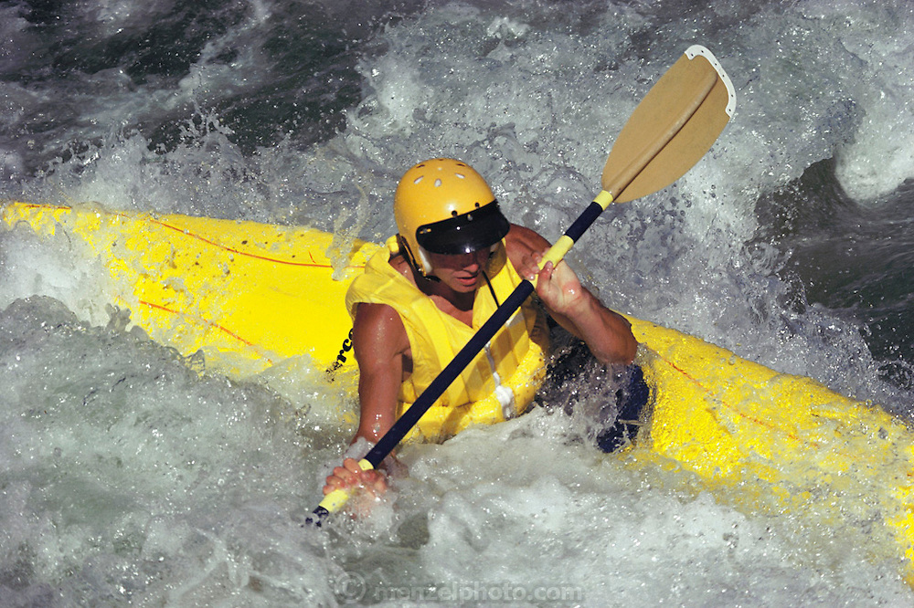 Kayaking down the Toulumne River in Northern California. Sports.