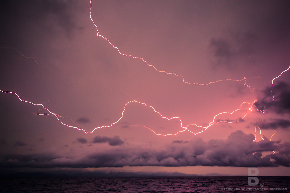Bolts of lightning during a tropical electric storm over the Caribbean Sea just before sundown.