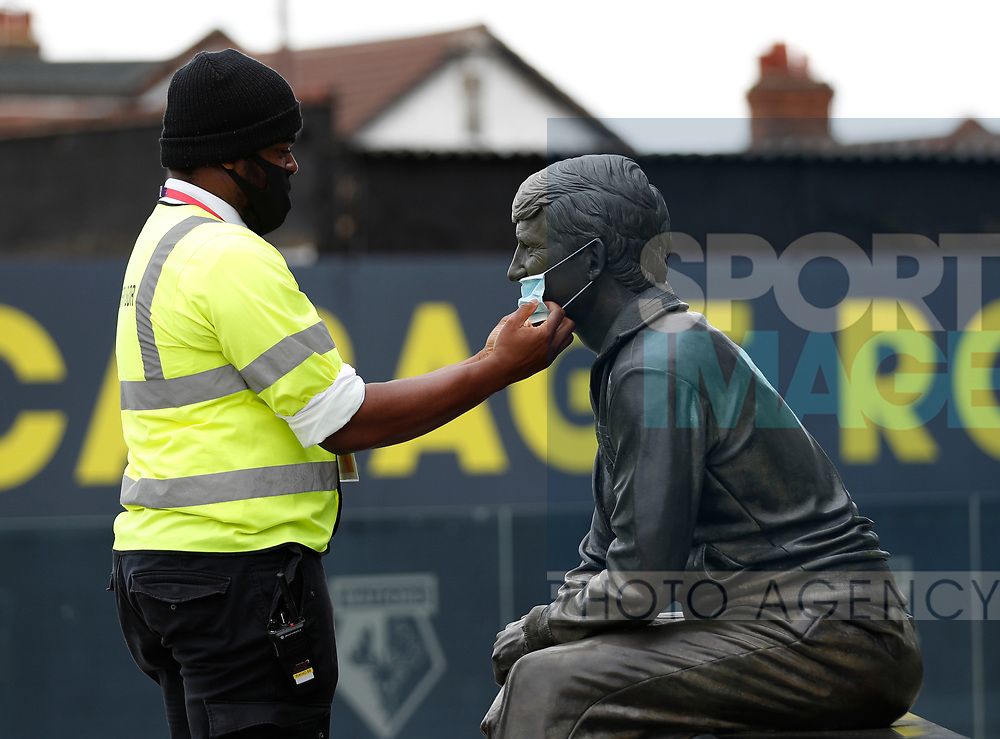 The statue of Watford legend Graham Taylor has a face mask adjusted before the Premier League match at Vicarage Road, Watford. Picture date: 20th June 2020. Picture credit should read: Darren Staples/Sportimage