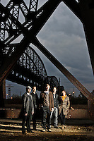 Promo portraits of the band Last To Show First To Go