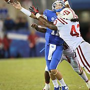 September 15, 2012 - Lexington, Kentucky, USA - UK quarterback  MAXWELL SMITH throws under pressure from WKU's JAMARCUS ALLEN in the second half as Western Kentucky University defeated the University of Kentucky, 32-31, on a trick play in overtime. (Credit Image: © David Stephenson/ZUMA Press).