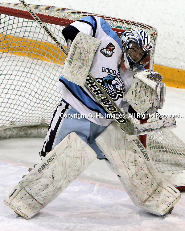 BURLINGTON, ON - Feb 18 : Ontario Junior Hockey League Game Action between the Toronto Lakeshore Patriots  and the Burlington Cougars, Cammron Radford #31 of the Burlington Cougar's makes the save..(Photo by Brian Watts / OJHL Images)