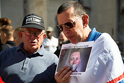 Supporters and counter protesters demonstrate outside The Royal Courts of Justice in London as an appeal by lawyers representing right wing activist Tommy Robinson win his release on bail ahead of a new hearing to be held at The Old Bailey, following his imprisonment on contempt of court charges. London, August 01 2018.
