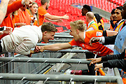 Brad Potts (8) of Blackpool celebrates the 2-1 win over Exeter with a fan during the EFL Sky Bet League 2 play off final match between Blackpool and Exeter City at Wembley Stadium, London, England on 28 May 2017. Photo by Graham Hunt.