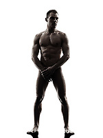 one  handsome naked muscular man tanding full length in silhouette studio on white background