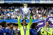 Chelsea Goalkeeper Thibaut Courtois (13) celebrates with the trophy during the Premier League match between Chelsea and Sunderland at Stamford Bridge, London, England on 21 May 2017. Photo by Andy Walter.