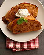 french toast on a white plate with picnic checkered napkin