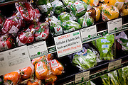 Tokyo, August 16 2011 - In National Azabu, a supermarket targetting the foreign community in Tokyo, a sign of certification of radiation safety for vegetables .