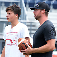 Connor Barth talks to Josiah Eason, 17, Sunday July 13, 2014 during a kicking clinic at Hoggard High School in Wilmington, N.C. (Jason A. Frizzelle)