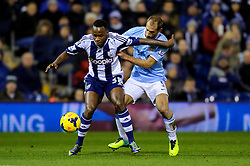 West Brom Forward Saido Berahino is tackled by Man City Defender Pablo Zabaleta (ARG) during the first half of the match - Photo mandatory by-line: Rogan Thomson/JMP - Tel: Mobile: 07966 386802 - 04/12/2013 - SPORT - FOOTBALL - The Hawthorns Stadium - West Bromwich Albion v Manchester City - Barclays Premier League.