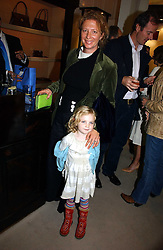 SAMANTHA WEINBERG and her daughter AMBER at a party to celebrate the 10th anniversary of the Smythson Fashion Diary and to the launch of the 2007 Limited Edition held at Smythson, New Bond Street, London on 25th October 2006.<br />