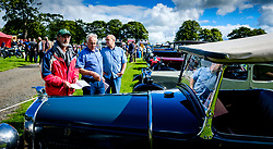 The 44th Biggar Vintage Vehicle Rally held in Biggar on 13th August 2017.  People admiring the vehicles.<br /> <br /> (c) Andrew Wilson | Edinburgh Elite media